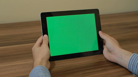 Man Using Horizontal Digital Tablet tap hand gestures with Green Screen on the B Footage