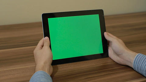 Man Using Horizontal Digital Tablet tap hand gestures with Green Screen on the B Filmmaterial