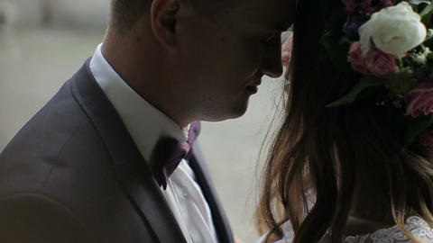 Close-up of Beautiful bride and groom gently hugging and in the courtyard of the