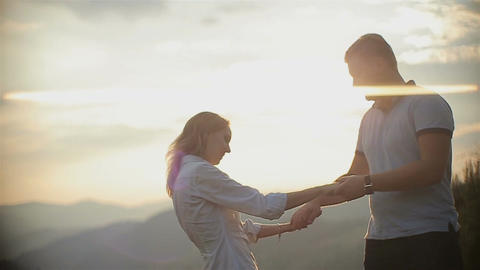 Charming couple in love have fun in the mountains on sunset Live Action