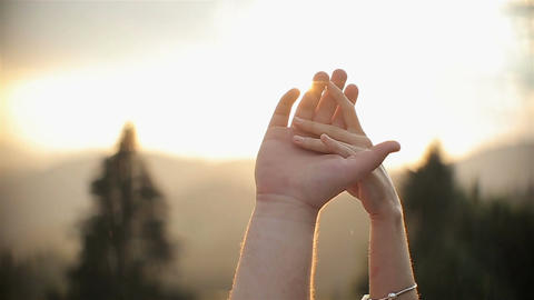 Hands charming couple on Beautiful sunset background Live Action