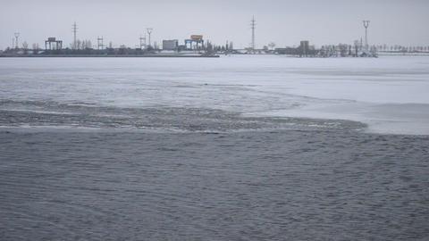 Ice melting on water storage reservoir near Kiev, Ukraine Footage