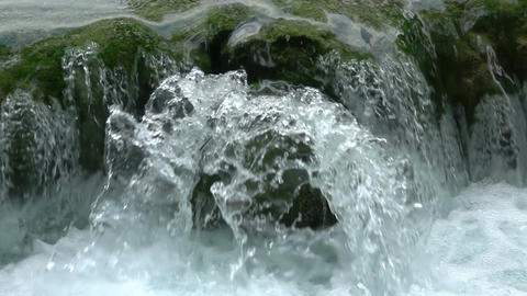 Waterfall on a Mountain River Close-up. Slow Motion Footage