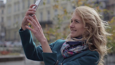 Girl taking selfie with smartphone smiling happy Footage