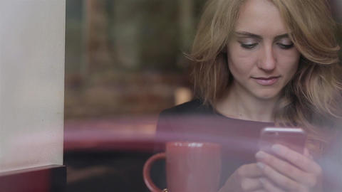 Woman using app on smartphone smiling and texting on mobile phone Footage