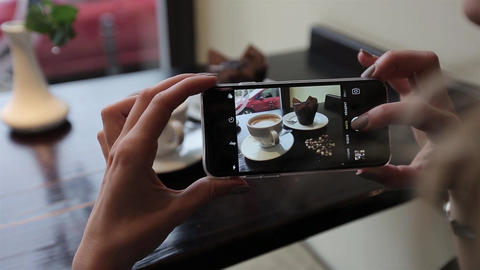 Attractive young woman Photographing food in restuarant cafe. closus-up Footage