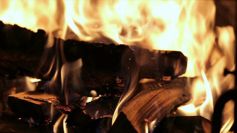 Slow motion of Fireplace burning. Warm cozy burning fire in a brick fireplace cl Footage