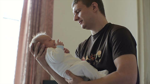 Father Holding a little son at home.Beautiful little baby Footage