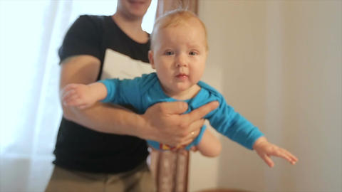 Father playing with baby at home Footage