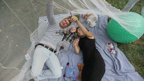 Happy family have fun in beatiful decoretion. Little baby have fun with his pare Live Action