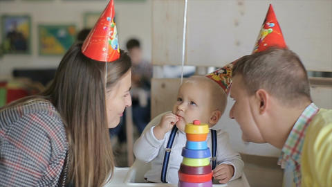 Little boy celebrating his birthday with his parents in cafe.Young Family have f Filmmaterial