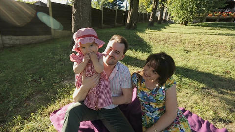 Happy family have fun in backyard. Little baby have fun with his parents Footage
