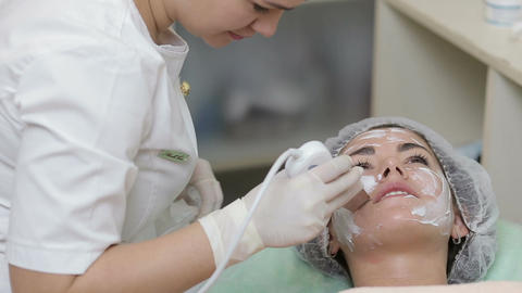 Young woman getting ultrasonic deep facial cleansing in cosmetology salon Footage