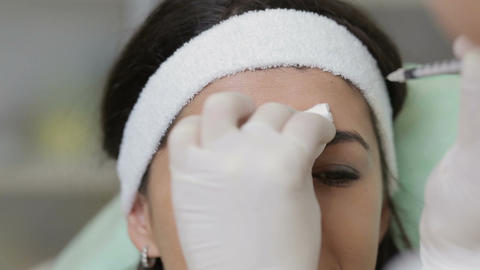 Close up of young woman having a botox injection at beauty salon Footage