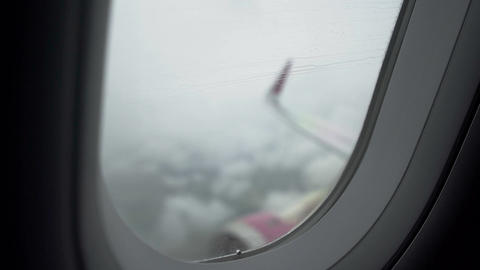 Passenger airliner flying in low visibility rainy sky, high risk of accident Footage