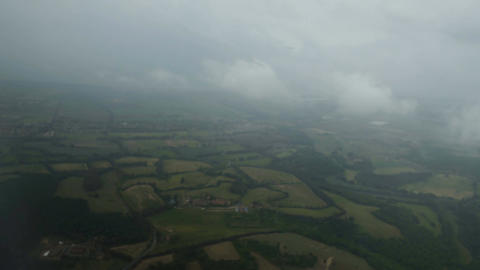 Clouds flying in foggy sky above green fields, air mass movement, rainy weather Footage