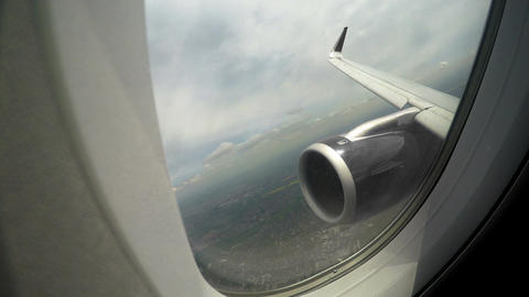 View through window at plane wing and engine, risk of accident during flight Footage