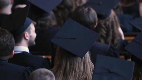 Many graduates applauding at graduation ceremony, future of national economy Footage