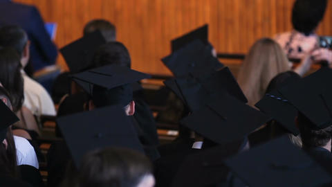 Business academy graduates listening to speech, ready to receive certificates Footage