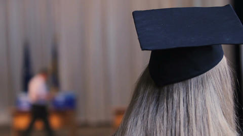 Blonde woman in academic cap, female ready to receive higher education diploma Live Action
