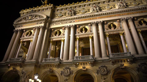 High white columns of illuminated Opera building in Paris, ancient architecture Footage