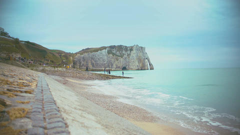 People relaxing on coastline in Etretat town, enjoying amazing view of nature Footage