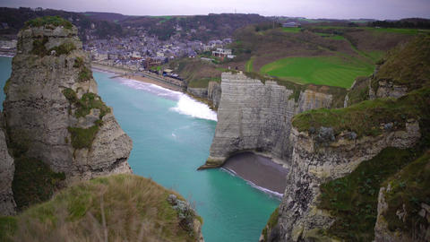 View on Etretat town and empty beach between white chalk cliffs, France Footage