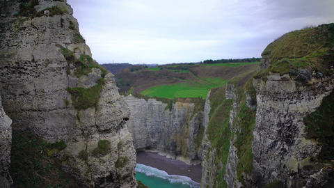 Beautiful view on white chalk cliffs and empty beach from mountain, Etretat town Footage