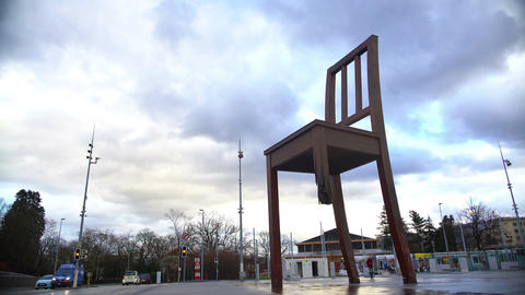 Broken Chair memorial near Palace of Nations, tourists taking photos, panorama Footage