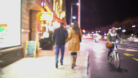 POV of jealous husband following his unfaithful wife in the street at night Footage