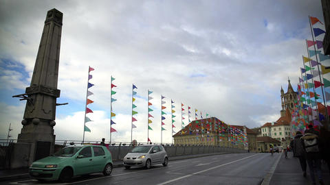 Tourists walking across Lausanne bridge decorated with many colorful flags Footage