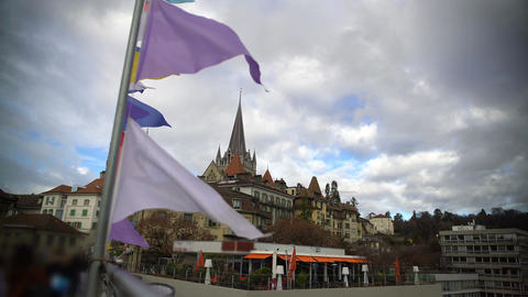 View on Notre-Dame cathedral from Lausanne bridge decorated with colored flags Footage