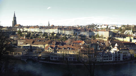 Old European city from above, beautiful river and old houses on sunny winter day Footage