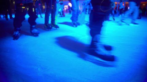Happy people enjoying winter holidays, skating on ice rink, outdoor activities Footage