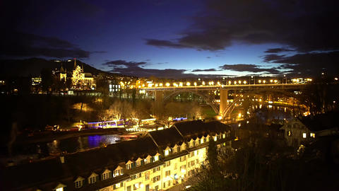 Evening view of beautiful Bern city, illuminated bridge and houses, tourism Footage