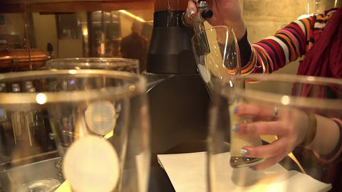 Bartenders hands pouring beer in glass, catering business, brewing industry Live Action