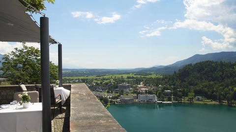 Amazing view from fancy restaurant terrace at lakeside town and high mountains Footage