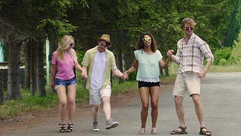 Young joyful friends dancing and having fun in park, summer holidays, youth Live Action