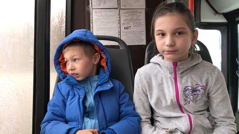 Children go in a city bus