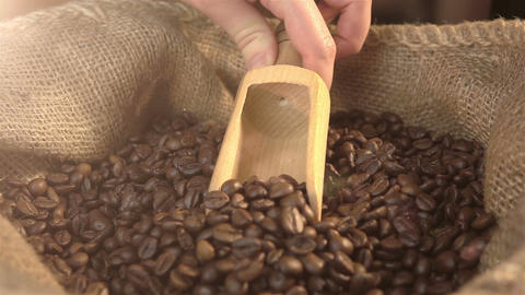 Video of scooping coffee beans in real slow motion Footage