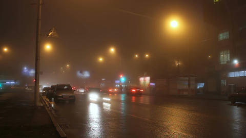 The lights of night city in fog and cars on way Filmmaterial