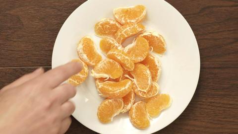 Overhead of Couple Eating Mandarin Orange Healthy Snack Live Action