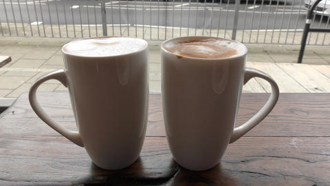 Morning latte. Coffee in two cups ビデオ