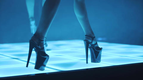 Walking in High Heels while Pole Dance in Night Club Footage