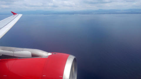looking on wing with engine and sea from airplane Footage