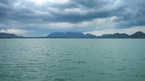 View from moving boat on islands and moody sky Footage