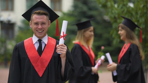 Laughing graduate rejoicing diploma and graduation ceremony, happiness Footage