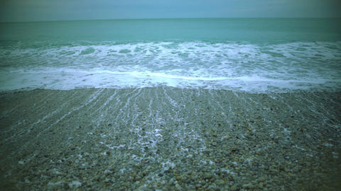 Foamy sea waves washing pebble beach, relaxing marine landscape for meditation Footage