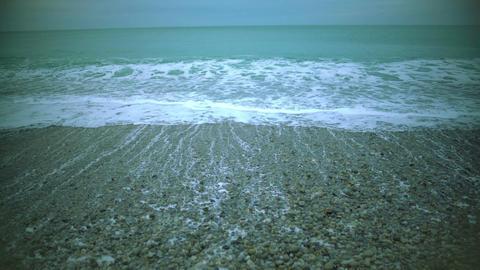 Foamy sea waves washing pebble beach, relaxing marine landscape for meditation Footage