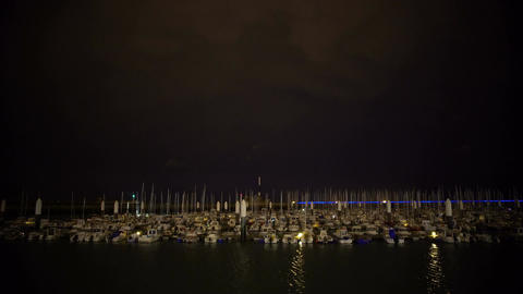 Calming night view on large yacht marina, parking for boats, transportation Footage